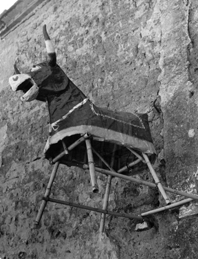 In this photo, another cane work frame with the papier mache shape of a bull called a torito, (little bull).